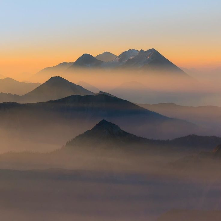Photo @ladzinski / Hazy sunrise over smoke filled valleys of #GlacierNationalPark from nearby fires some as far away as Washinton state. The ashy sky filling the park created an atmosphere and depth extenuating the complex landscape of the glacially carved terrain. Photo taken last October on assignment for an up and coming #climateChange story for @natgeo by natgeo