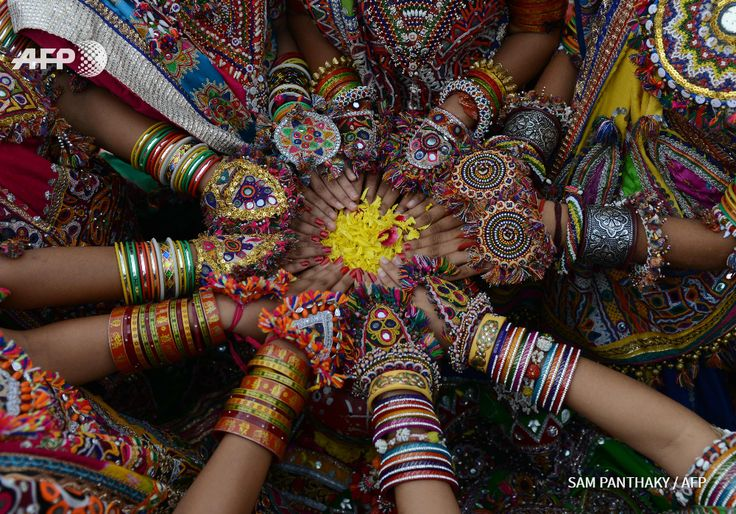 Indian folk dancers from the Panghat Group of Performing Arts pose for a photograph during a dress rehearsal for an event to mark the forthcoming Hindu festival 'Navaratri', or the Festival of Nine Nights, in Ahmedabad on September 25, 2016. The...