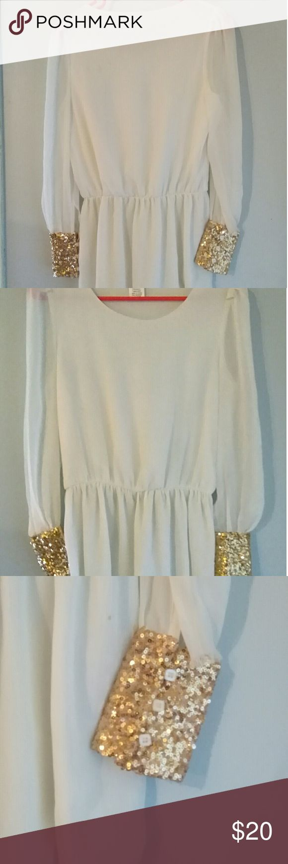 Charming Charlie Goddess White Tunic Dress Charming Charlie Goddess White Tunic Dress with Gold Sequined Cuffs that add a twist on traditional Tunic Dress.  Beautiful Dress. Worn only once. Size Small Charming Charlie Dresses