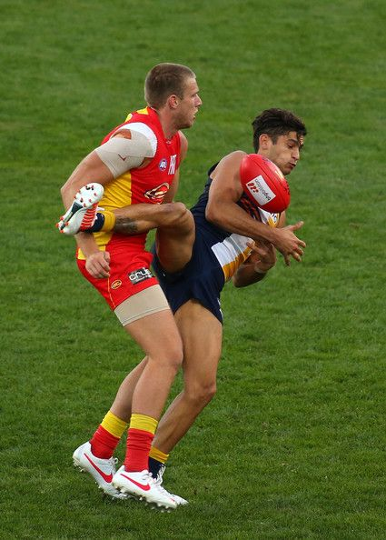 Sharrod Wellingham of the Eagles juggles a mark against Sam Day of the Suns during the round 13 AFL match between the West Coast Eagles and ...