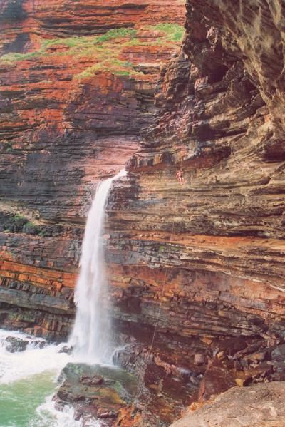 Waterfalls plunging into the ocean along the Wild Coast of South Africa.