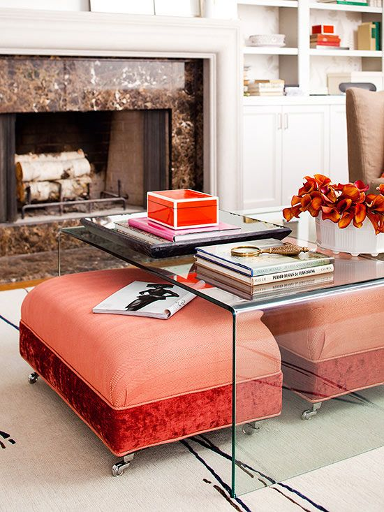 Even the upholstered furniture can be smartly stored, as in the case of two colorful ottomans parked beneath a clear coffee table; they add versatility, ready to be pulled out at a moment's notice by family members wanting to prop their feet up while enjoying a good book or to seat an unexpected extra guest.