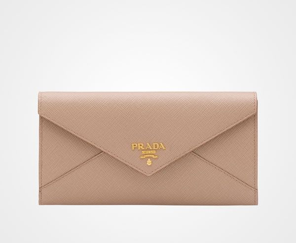 -Saffiano leather Gold-toned hardware Metal lettering logo Metal push-lock closure Six credit card slots Five document pockets Extractable badge holder Coin compartment with zipper One outside pocket with zipper