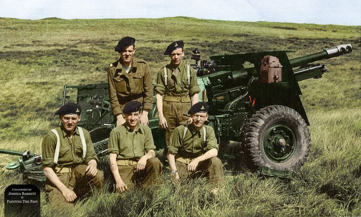 Ditchburn Bonney, of 151st Ayrshire Yeomanry, Royal Artillery, poses for a photograph with his crew in front of their 25pdr, presumably during training exercises somewhere in the UK.