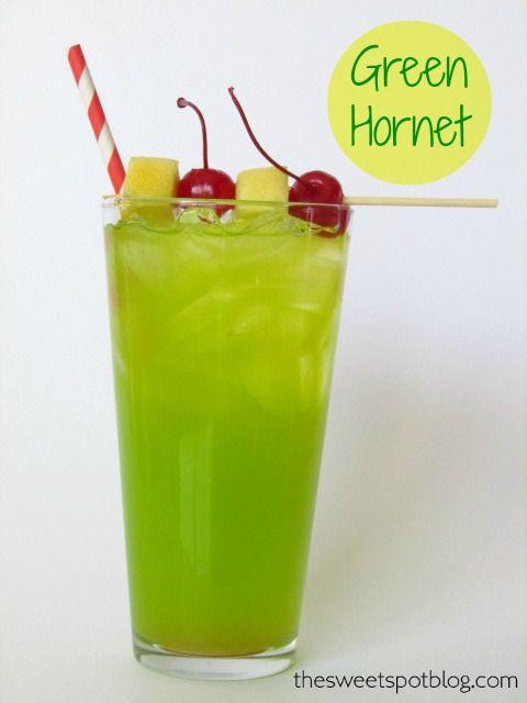 The Green Hornet ~ 1 oz Midori Melon Liqueur, 1.5 oz Malibu Coconut Rum, Splash of Triple Sec Liqueur, Pineapple Juice, Maraschino Cherries, Fresh Pineapple