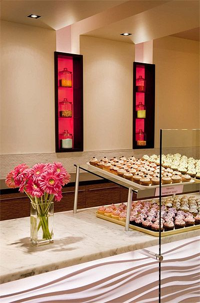 *Pink insert shelving* Hot Cupcake Bakery Shop Design - Design by Bonstra|Haresign Architects