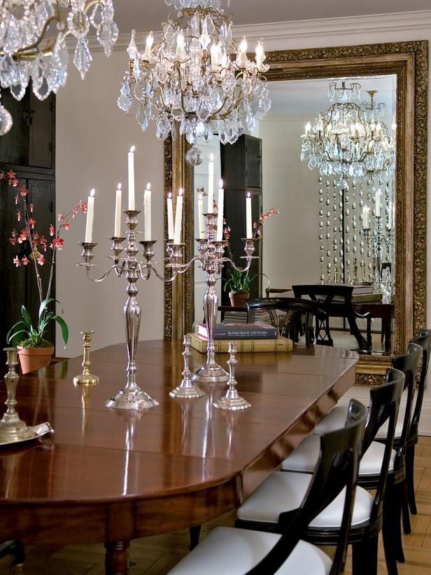 In this dining room the light from a pair of chandeliers for Chandeliers for dining room traditional