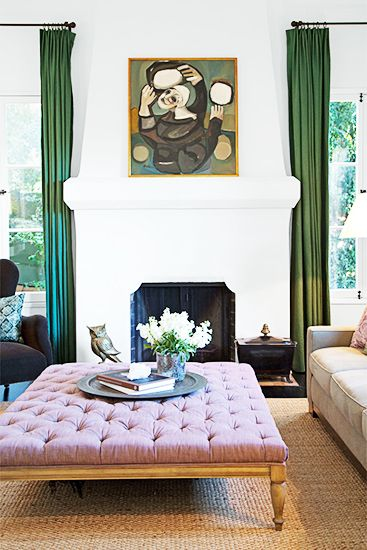 Your Guide to Decoding Popular Décor Lingo// tufted ottoman, coffee table ottoman, green drapery, white fireplace, modern fireplace: