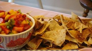 Cinnamon tortilla chips are dipped in a fragrant fruit salsa.
