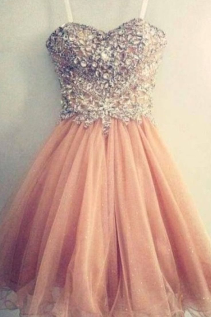 Pretty pink short dress with a sparkly bodess