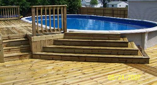 Picture of wooden pool deck repinned by normoe the for Above ground pool decks with bar