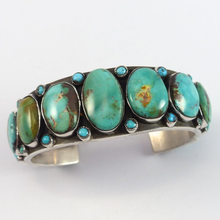"""Sterling Silver Cuff Bracelet set with Multiple Turquoise Cabochons and Hand Stamped Designs on the Interior of the Band. 1"""" Cuff Width 5.75"""" Inside Measurement, plus 1.25"""" opening (7"""" Total Circumfer"""