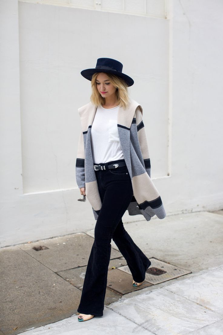 Let us all take notes from Late Afternoon's 7 For All Mankind Fashion Flare and cashmere sweater duo