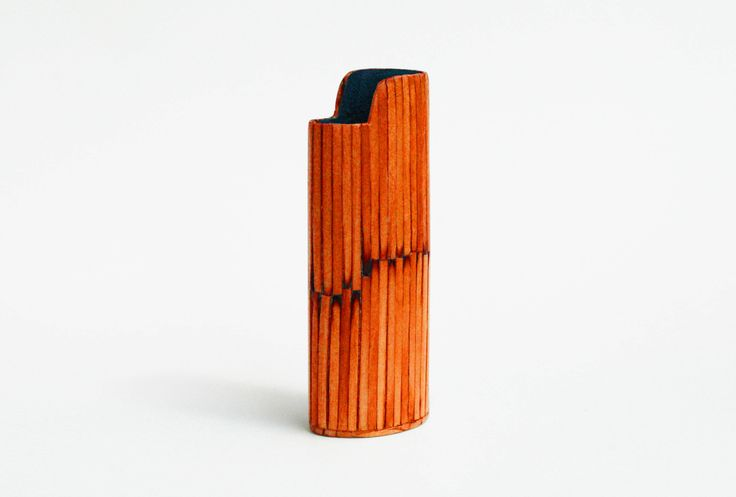 Handmade BIC Lighter Case by Burned Match Sticks - Orange color The handmade case for BIC lighter is made by burned match sticks.  The burned match sticks are glued one by one then they are smoothed, painted and polished.