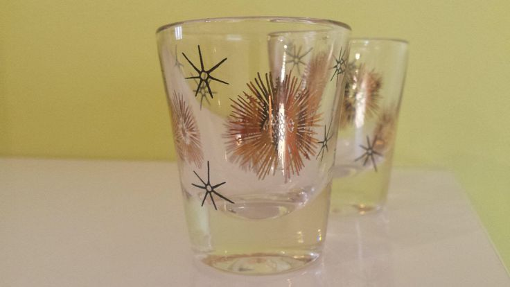 Atomic Barware Pair of Starburst Gold and Black Shot Glasses Hand Painted Beautiful Midcentury Design! by RetroSister on Etsy https://www.etsy.com/listing/504581570/atomic-barware-pair-of-starburst-gold