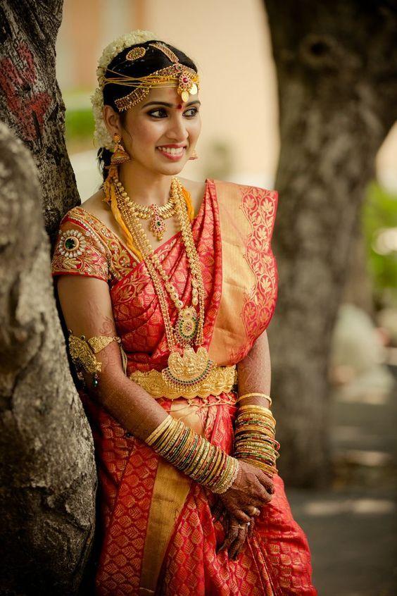 Red kancipuram silk saree with aari work blouse