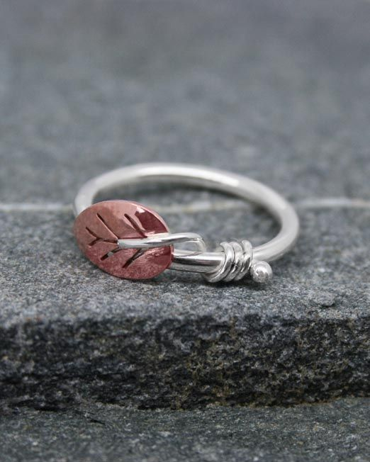 Handmade silver and copper leaf ring.  The leaf is hand saw pierced from copper sheet and has silver wire vine tendrils wrapped around a simple silver band.  Also available with a brass leaf.  #copper #handmade #leaf #ring #silver #starboardjewellery #jewellery #cornwall #uk #gb #westcountry #devon #england #silversmith #pretty #jeweller #jewellers #handmadejewellery #handmade