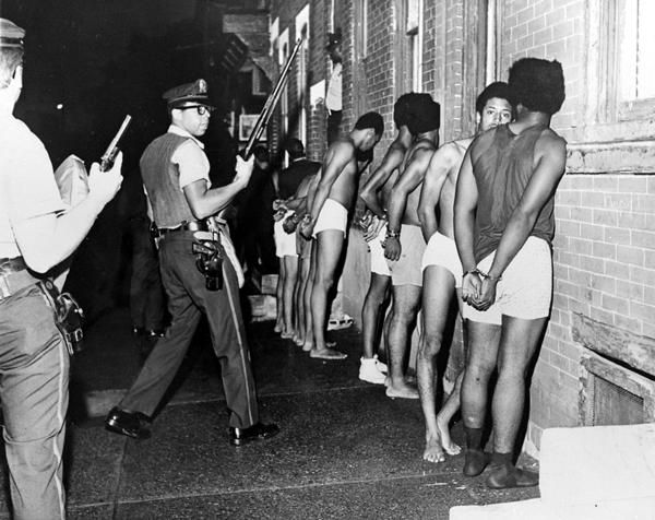 Members of the Black Panther Party, stripped, handcuffed, and arrested. This involved the black panthers group obviously.