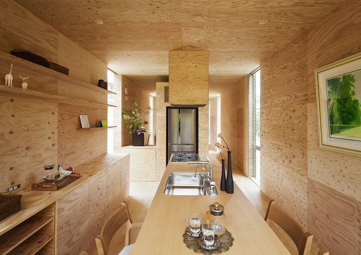 Raw plywood covers the interior walls and is complemented by pale cherry flooring.