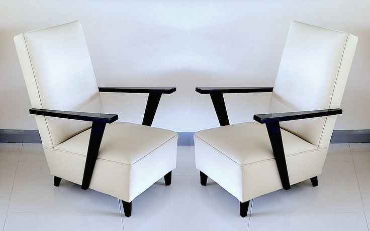 A pair of Art Deco influenced c.1950s black lacquer and cream leather chairs. New release to Scarab Antiques website www.scarabantiques.com