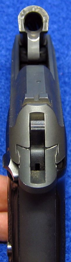 Rear view of Beretta 3032 Tomcat 32 ACP semi-auto pistol, with the barrel tipped up (opened). - Photo © Russ Chastain Find our speedloader now!  http://www.amazon.com/shops/raeind