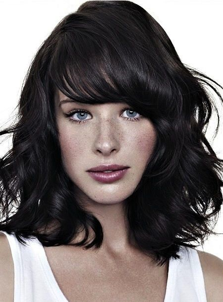 Layered and Curled with Bangs Medium Thick hairstyles