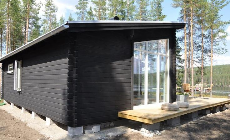 Scandinavian cabin style.  Elevated off ground with floating deck area.  Could deck around silver birch tree.