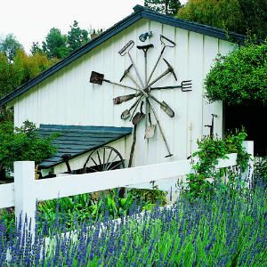 The spokelike arrangement of rakes, spades, and pickaxes attached to Julie Heinsheimer's barn in Rolling Hills isn't that just too pretty--these antique tools also recall pleasant memories.