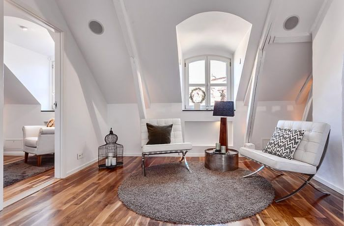 Loft in Sweden. Lots of modern interior design. Love the shape of the chairs pictured above.