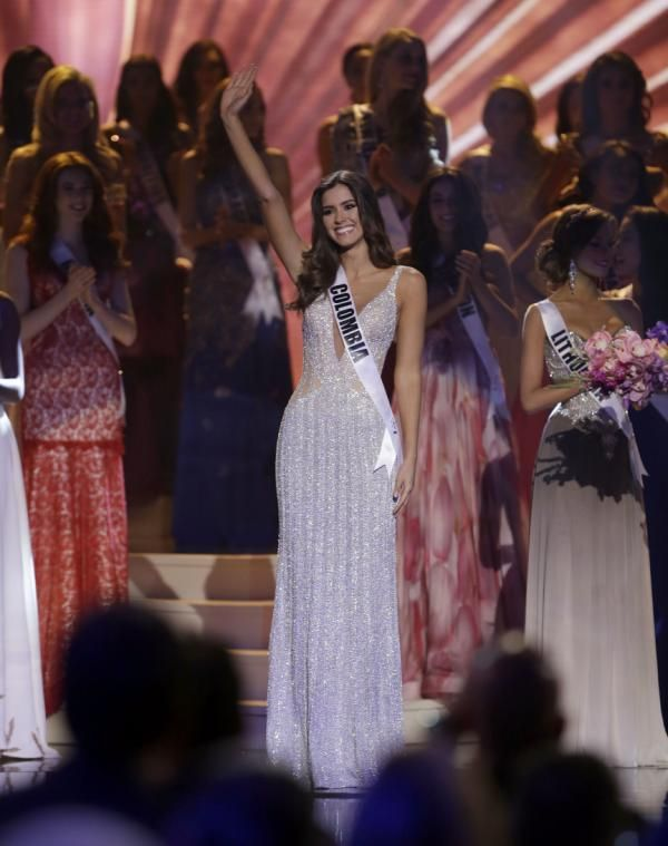 MIAMI (AP) — Miss Colombia Paulina Vega, a relative pageant newcomer, has been crowned Miss Universe, beating out first runner-up Miss USA Nia Sanchez and contestants from more than 80 other countries at Sunday's pageant in Miami.