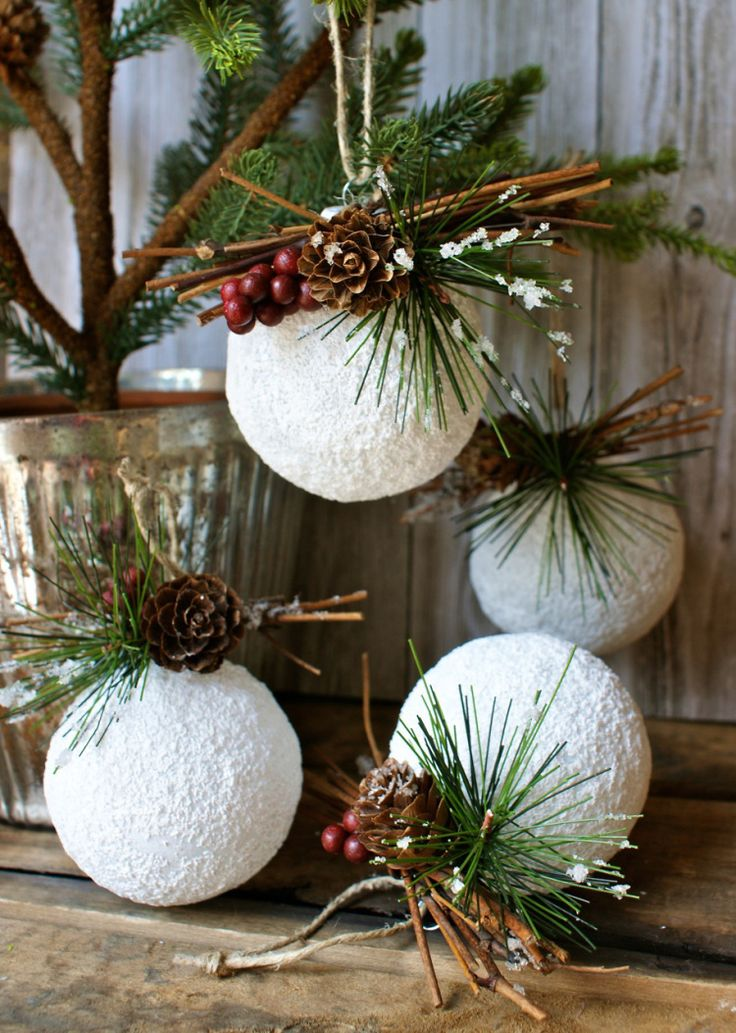 DIY Christmas ornament: styrofoam balls, snow paint, Christmas picks, twine.