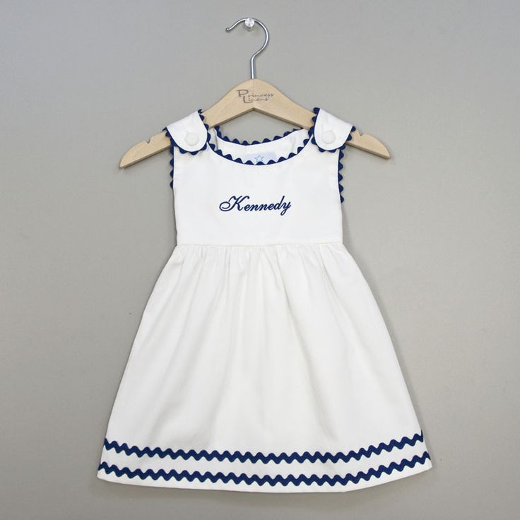 A classic combination, this white and navy ric rac dress from our Garden Princes… – Baby Girl Monogrammed Dresses