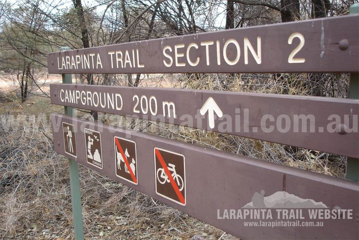 Typical Larapinta Trail signage. This is located at the main Simpson Gap area. The actual campground for Larapinta Trail walkers is away from all the crowds. © Explorers Australia Pty Ltd 2013