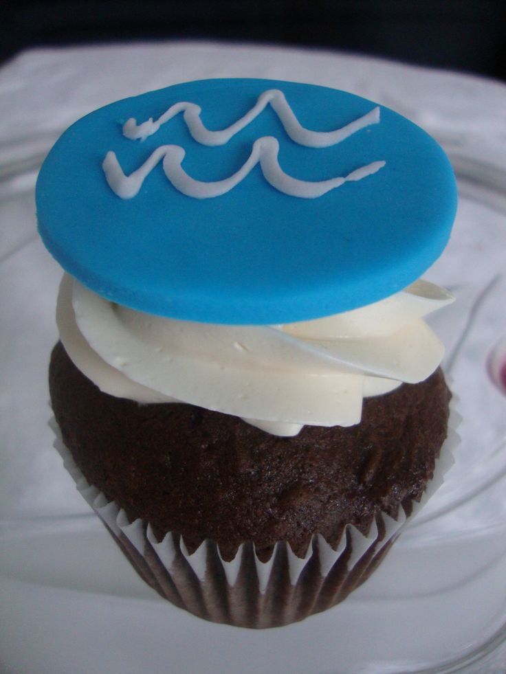 Chocolate Vanilla cupcake with Aquarius topper
