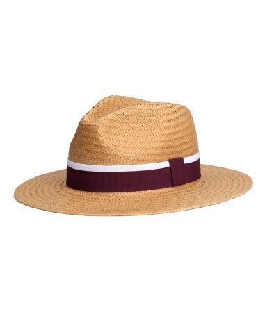 Hat in braided paper straw with a grosgrain band. Width of brim 2 1/2 in.