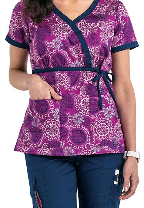 VIRAL SPIRAL Beyond Scrubs-exclusively ours and inspired by you! The dazzling Spirals top from the Beyond Scrubs collection is destined to be one of your favorite tops! In addition to the eye-catching colorful medallion design, this mock wrap top has a tie wrap that is designed to flatter your shape. Two roomy pockets provided you plenty of space to carry your accessories. Beyond Scrubs Spirals Purple Tie Wrap Print Scrub Tops V-neck Side slits Medium center back length 25 1/2