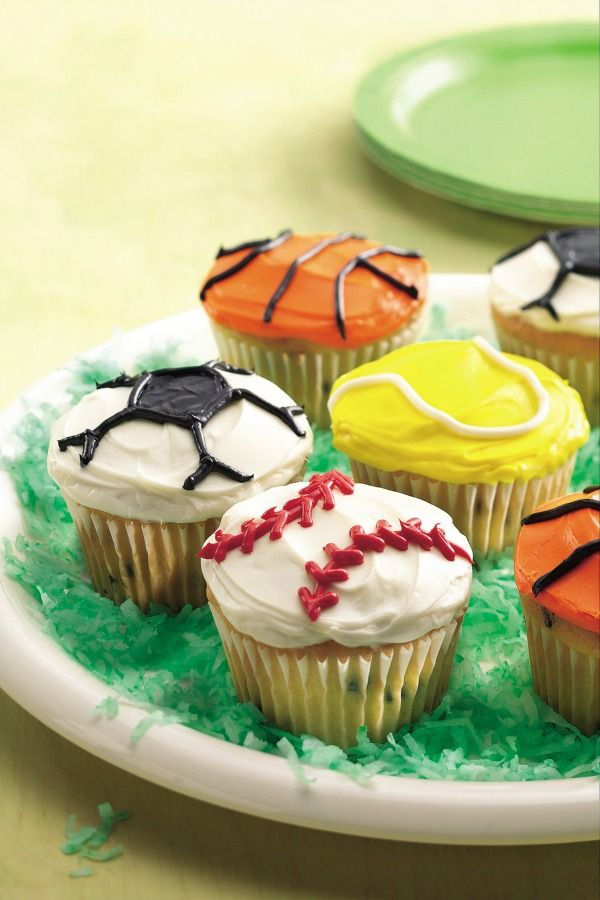 """No matter your sport of choice, treat the whole team to these athletic-inspired cupcakes. Make a green-grass """"turf"""" for them with green food coloring and shredded coconut! Click through to get the step-by-step video instructions."""