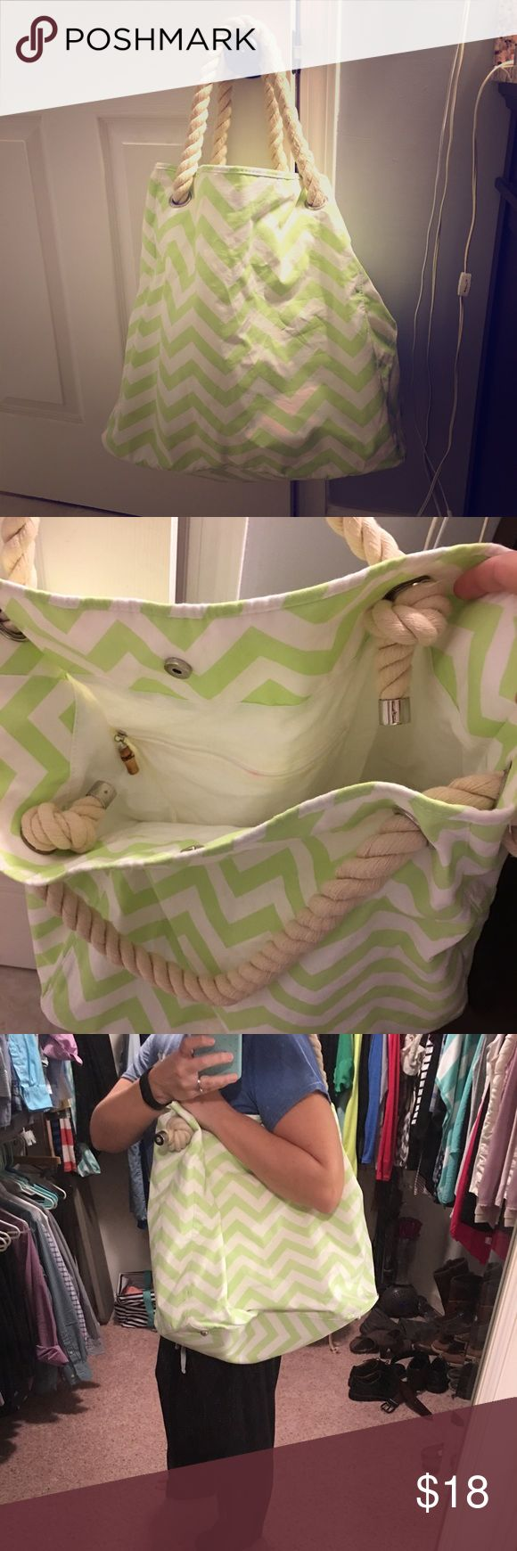 Oversized beach bag or tote Lime green and white chevron with rope straps. There is one zipper pocket inside and a couple other pockets that don't zip. Perfect for lugging beach towels or toys to the pool. Like new condition. There is one tiny pink spot on the inside zipper. Bags Totes