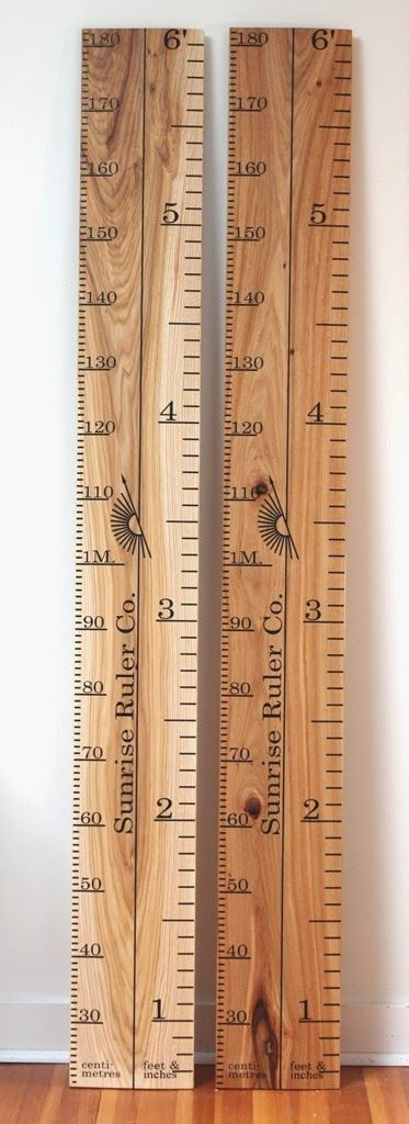 Sunrise Ruler Company, bevelled wooden ruler growth chart. I like how these have both English and metric measurements, and how the numbers face sideways like on a regular ruler. For the school room, right next to the closet door.