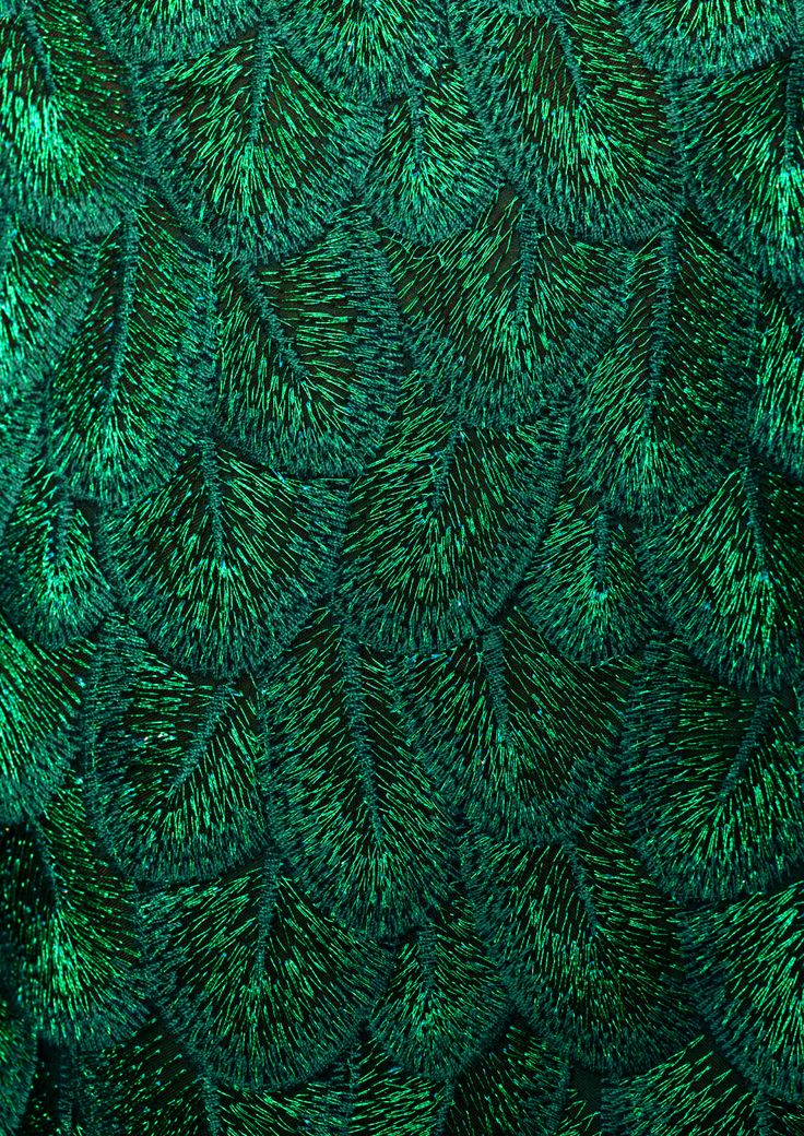Feathers have a mythical history and assumed great symbolism often connected to spirituality. Their magical appearance reached the world of fashion in the Middle Ages.  The fascination with feathers continued in the 18th, 19th and 20th centuries as entertainers and ordinary women fell in love with the boa. With embroideries and shimmering green tones, our festive season dress pays homage to this precious adornment in a contemporary way.