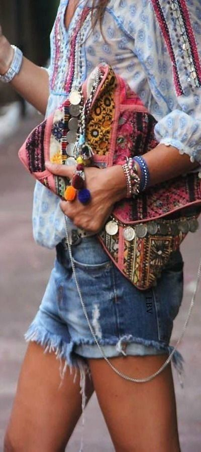 Boho chic crochet embellished peasant blouse top with modern hippie cut off denim blue jean shorts and gypsy style coin clutch purse.