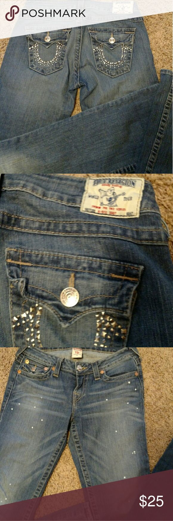 Women TRUE RELIGION distressed jeans Women distressed  light Denim True Religion jeans. Size 28/33. The white spots in front are the style of the jeans. Doesn't say if boot cut , regular etc in guc. Jeans