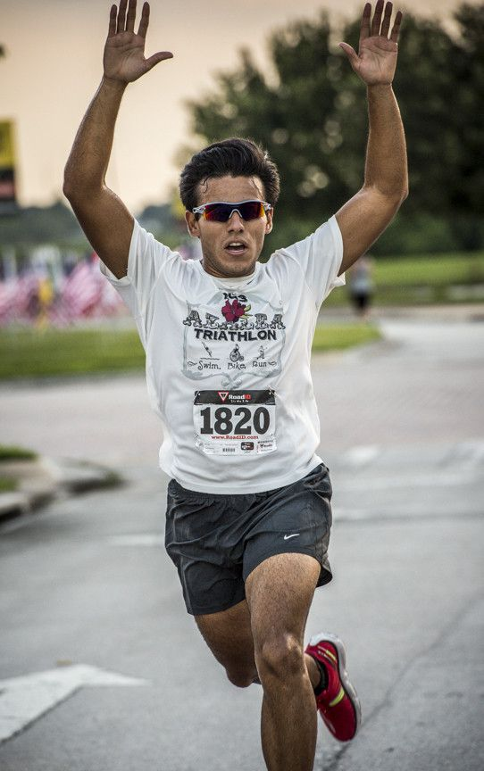 Christopher Garcia finishes first with a time of 18:52. Valencia College Alumni Association, and the Rotary Club of Lake Nona hold a 5K and 2.5K race at Valencia College's Osceola Campus in Kissimmee, on Saturday, Sept. 7, to raise money for scholarships for first responders. Photo by Roberto Gonzalez