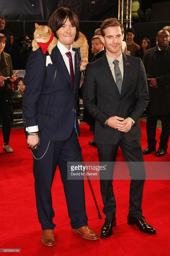James Bowen with Bob The Cat (L) and Luke Treadaway attend the UK Premiere of 'A Street Cat Named Bob' in aid of Action On Addiction at The Curzon Mayfair on November 3, 2016 in London, United Kingdom.