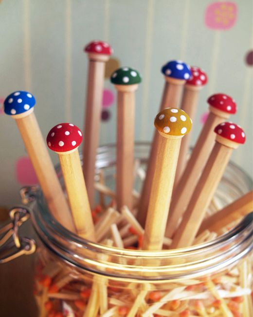 Toadstool pencils! -  Simply glue wooden buttons to the tops of wooden pencils and paint!