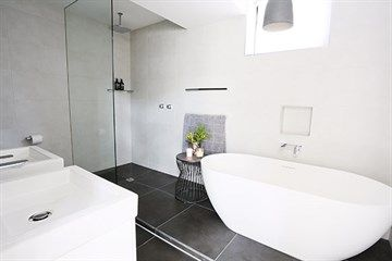 The Block 2013 charcoal dark grey bathroom tiles standalone bath