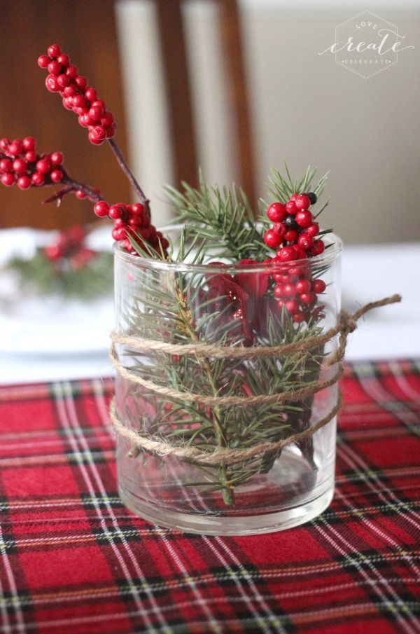 Festive Christmas decor! Fill a simple clear vase with berries and greenery, and wrap it in jute string.
