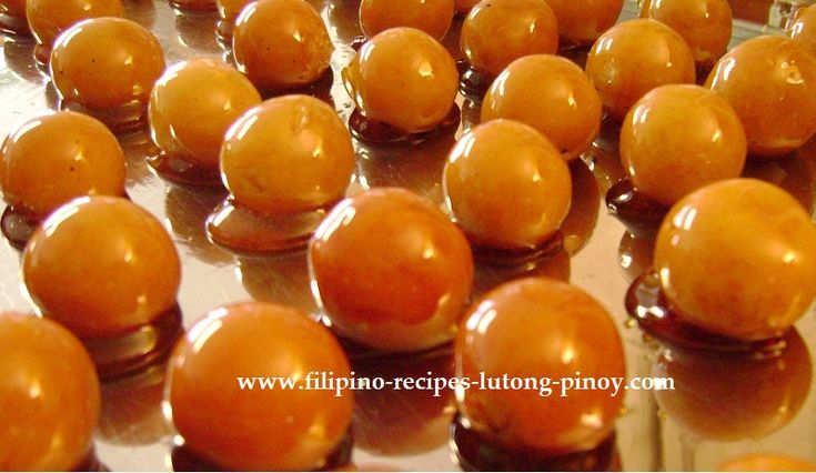 Filipino Yema sweets Ingredients: 2 medium sized cans condensed milk 3 egg yolks 1 tbsp margarine or butter 3 tbsp peanuts, chopped toothpicks or cellophane for wrapping