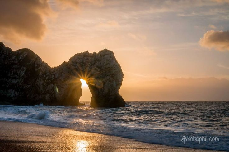 Near the winter equinox at Durdle Door on the Jurassic Coast, a World Heritage Site on the English Channel coast of southern England. This shot is a rarity, since it can only been taken around the winter equinox, for about 7 - 10 days during the year.