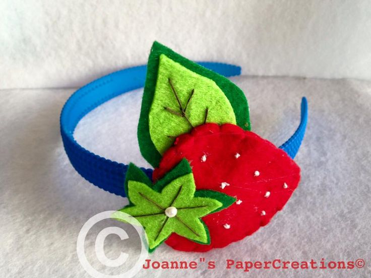 A felt strawberry headband for a Spring appearance of a small young lady crafted by Joanne's PaperCreations.
